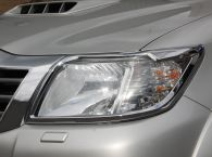 Chrome Plastic Headlamp Trim Cover shown on vehicle